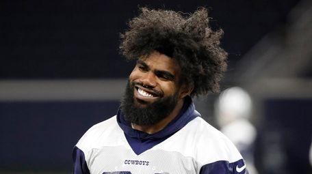 Dallas Cowboys running back Ezekiel Elliott smiles as