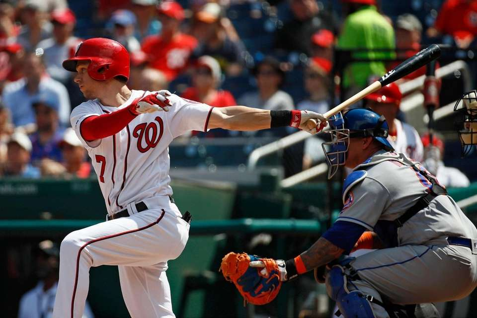 The Washington Nationals' Trea Turner singles in front