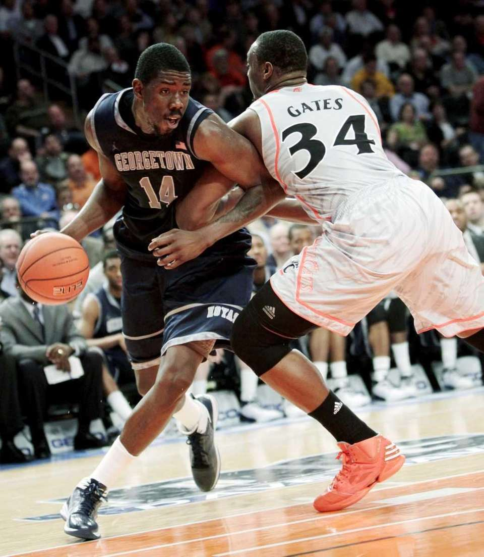 Georgetown's Henry Sims, left, tries to get past
