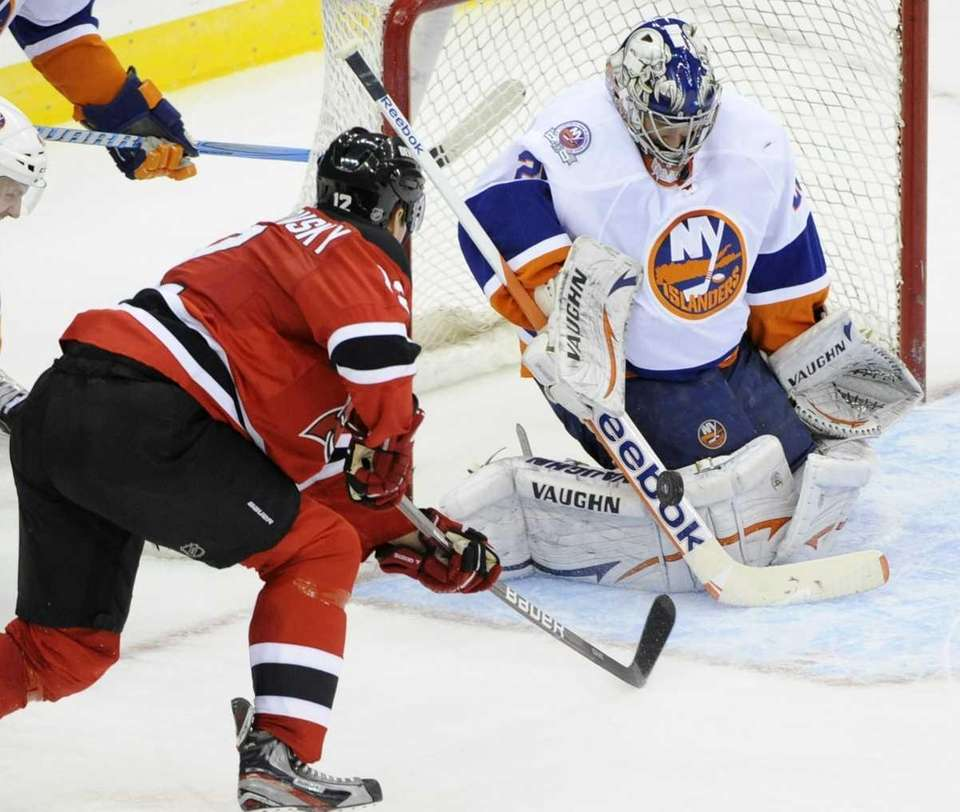 Islanders goaltender Evgeni Nabokov makes a save on