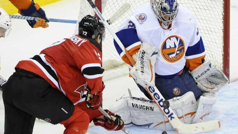 Islanders goaltender Evgeni Nabokov makes a save on