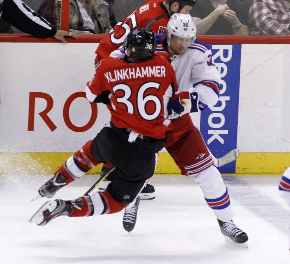 Ottawa Senators' Rob Klinkhammer is checked by Rangers'