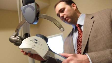 Dr. Michael Genovese is pictured with the NeuroStar
