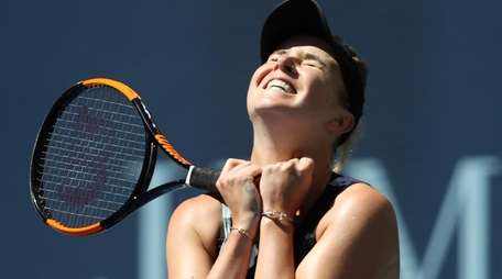 Elina Svitolina reacts after defeating Johanna Konta in