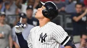 Yankees rightfielder Aaron Judge reacts after he scores