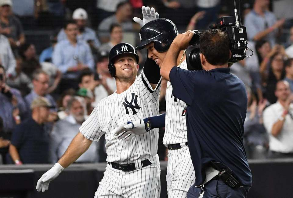New York Yankees' Aaron Judge is greeted by