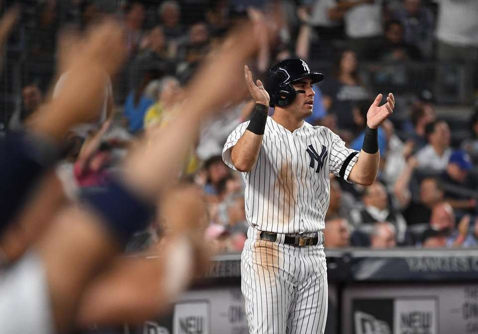 New York Yankees' Mike Tauchman reacts after he