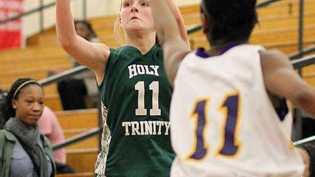 Holy Trinity's Kelly Carey hits from outside during