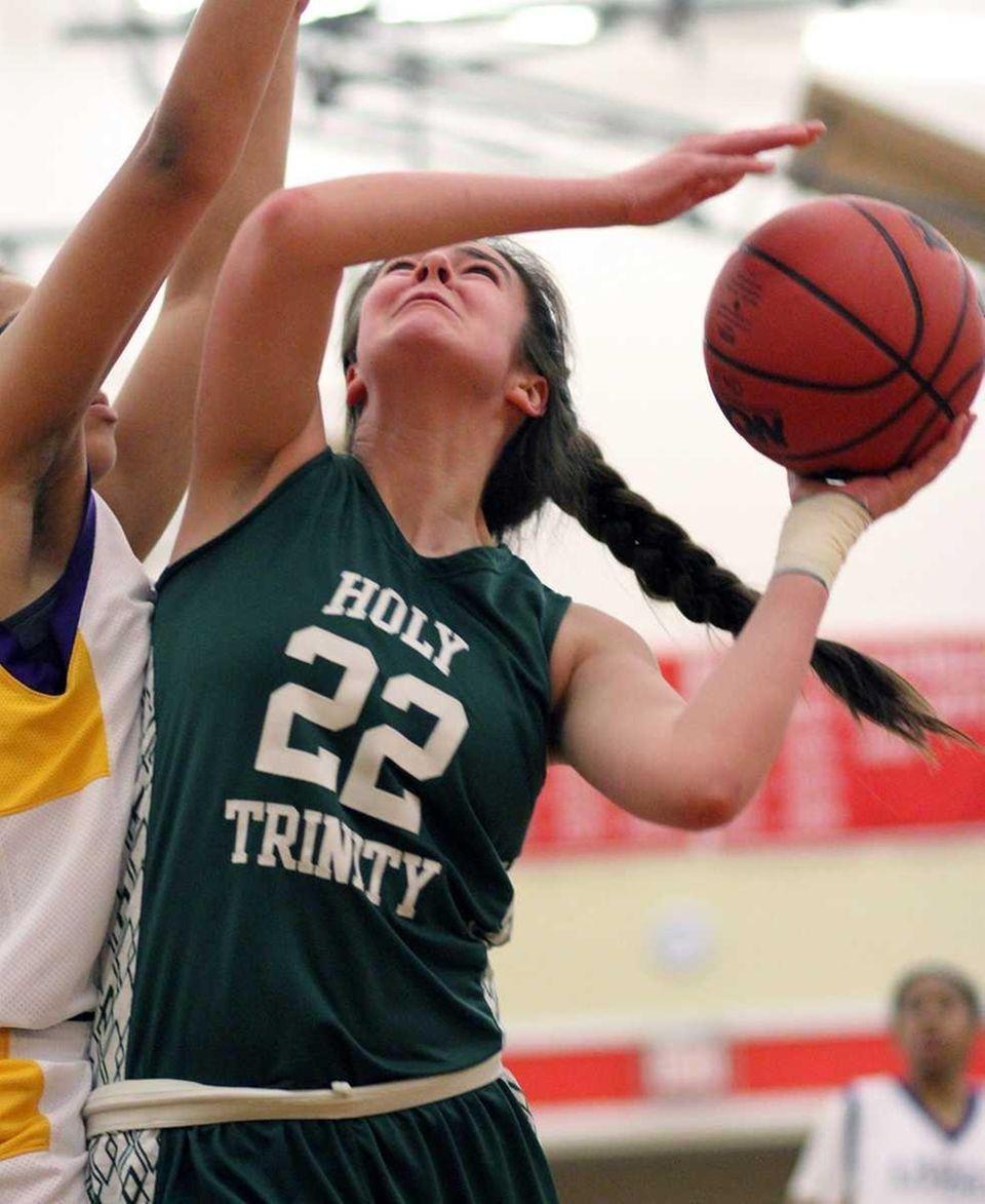 Holy Trinity's Alyson Brennan gets the basket underneath