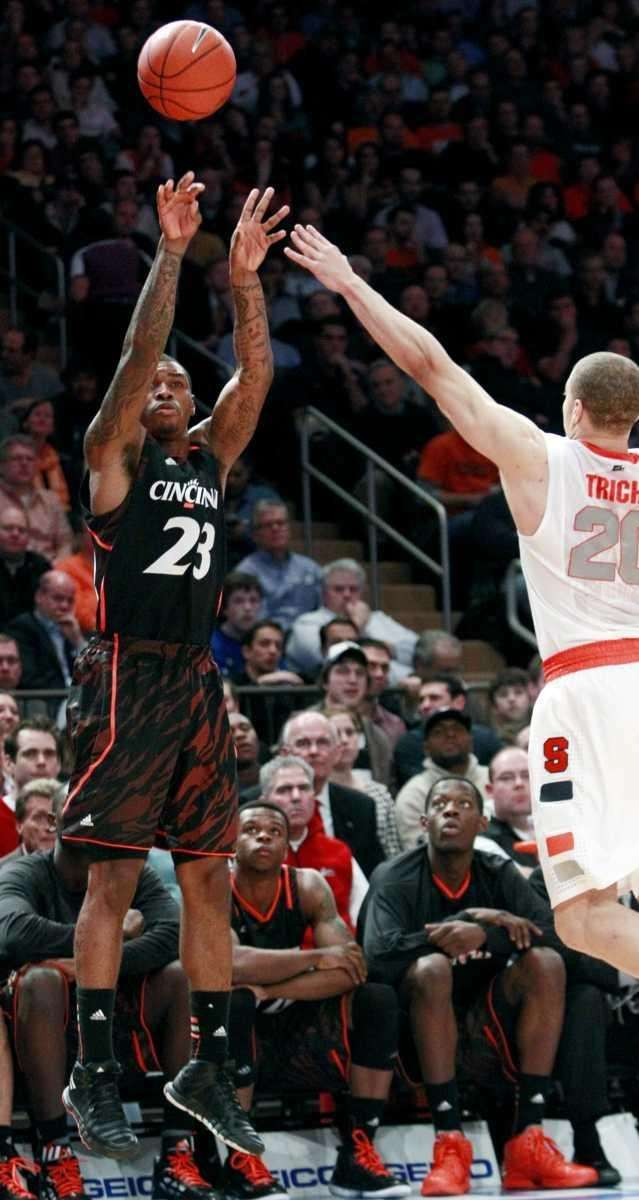 Cincinnati's Sean Kilpatrick (23) shoots over Syracuse's Brandon