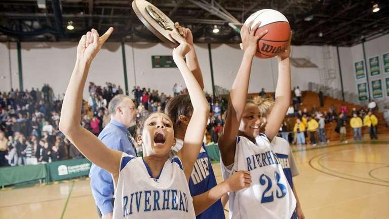 Riverhead players Naysha Trent, center, and Melodee Riley,
