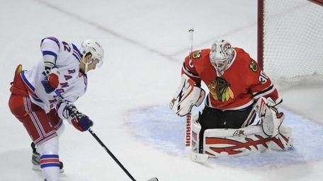 New York Rangers' Artem Anisimov left, prepares to