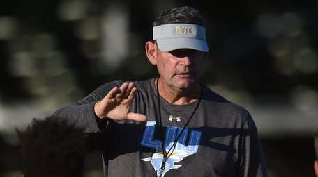 LIU football head coach Bryan Collins talks to