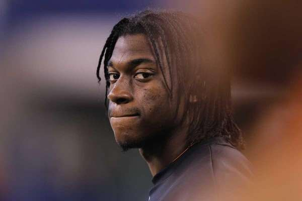 Quarterback Robert Griffin III of Baylor looks on