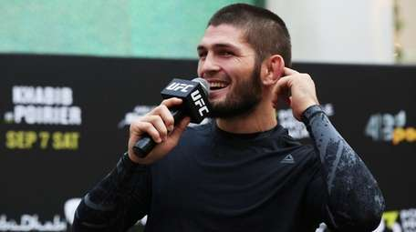 UFC fighter Khabib Nurmagomedov gestures to the crowd