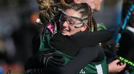 Carle Place Emiline Biggin, right, celebrates the win
