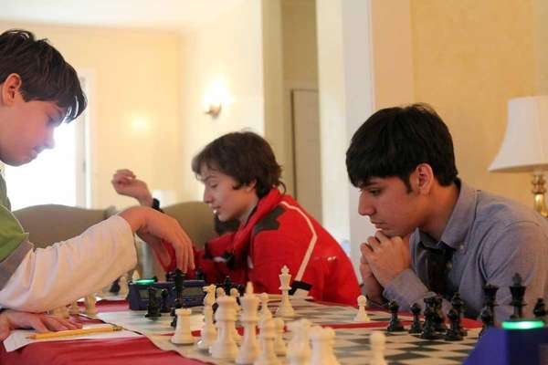 Friends Academy chess players Alex Pakh and Jahan