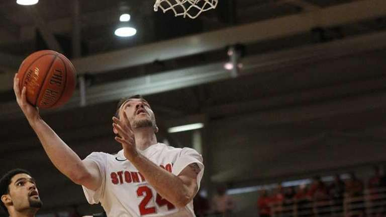 Stony Brook's Tommy Brenton (24) drives to the