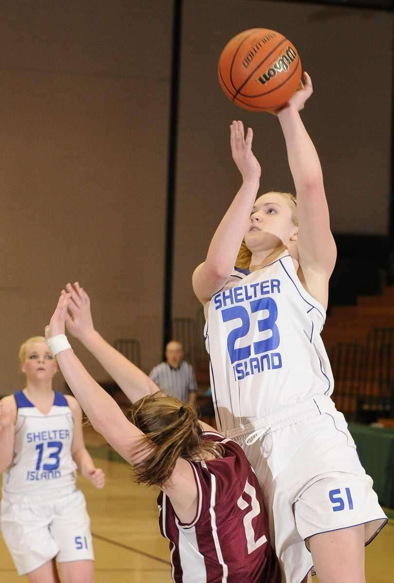 Shelter Island forward Kelsey McGayhey is fouled by