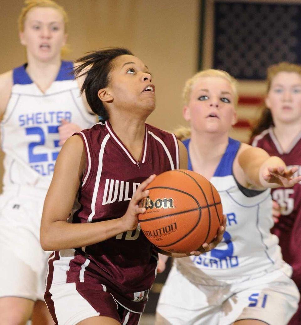 Livingston Manor guard Imani Miranda shoots ahead of