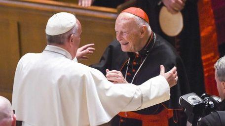 Then-Cardinal Archbishop emeritus Theodore McCarrick (C) greets Pope