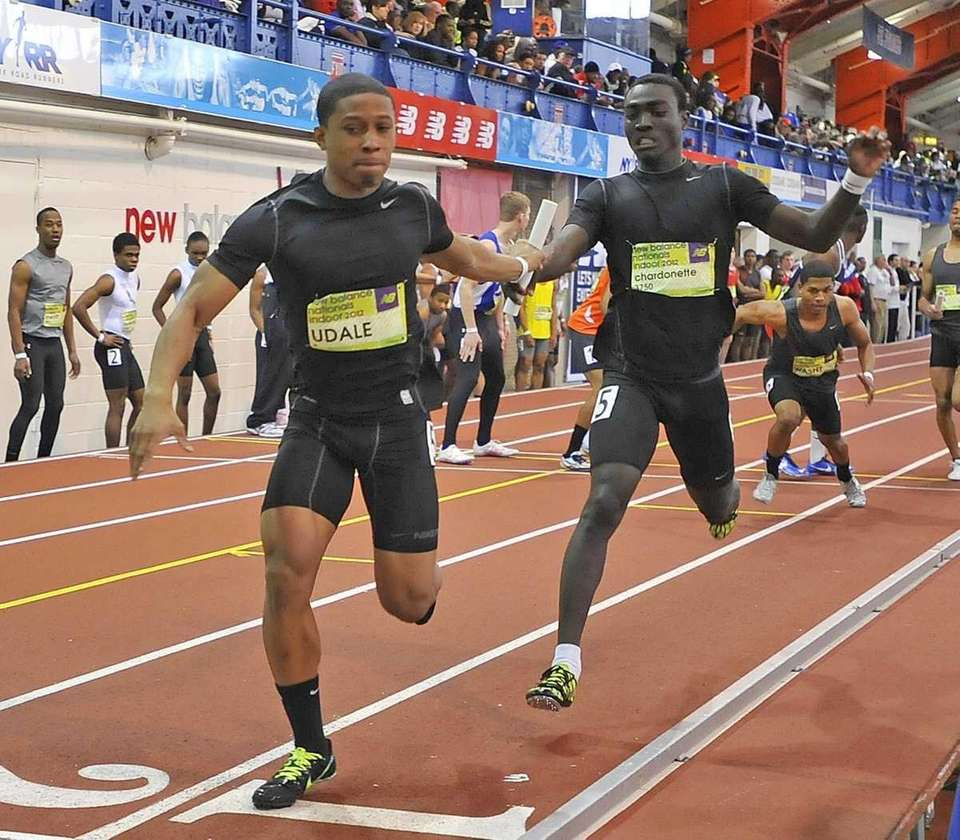 Davon Henry, left, takes the baton from Uniondale