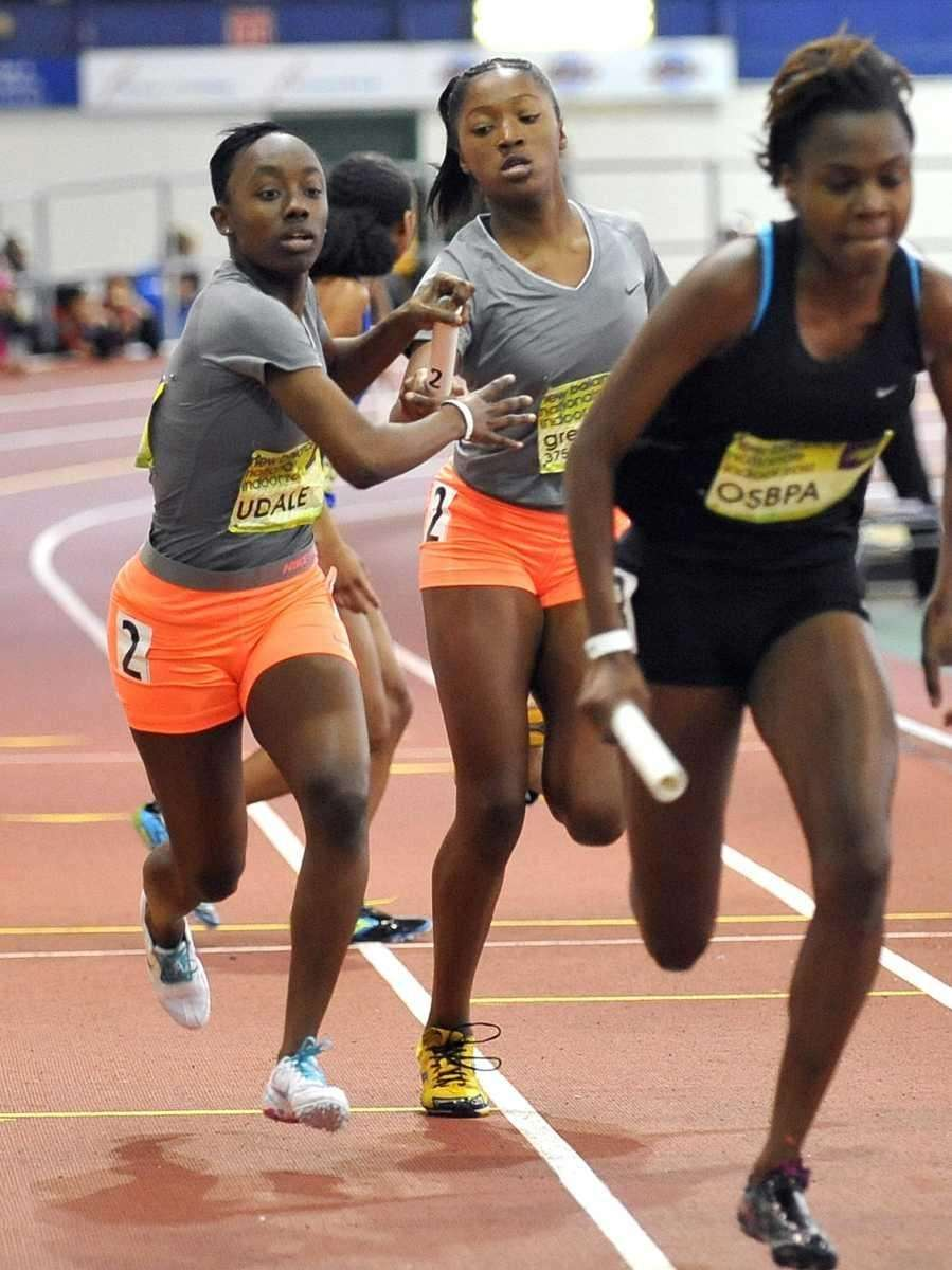 Uniondale's Timaya Forehand, left, takes the baton from