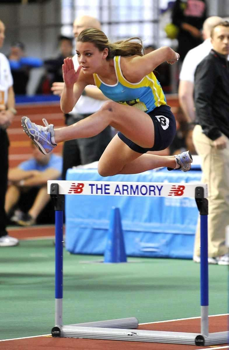 Lisa Abramski of Kellenberg clears the hurdle in