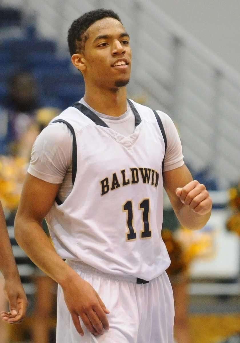 Baldwin's Brandon Williams smiles after his team's 68-57