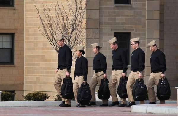 Marching in a tight formation, midshipmen at the