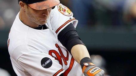 Baltimore Orioles' Nolan Reimold singles during the 10th