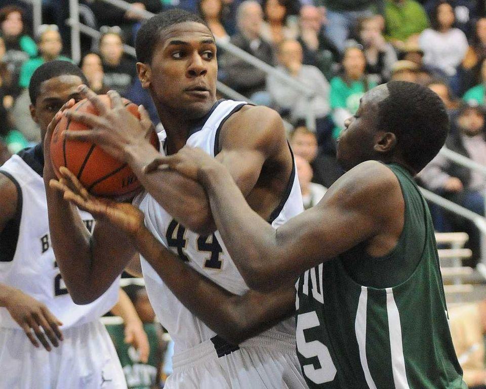 Baldwin's Jordan Williams, left, shields the ball from