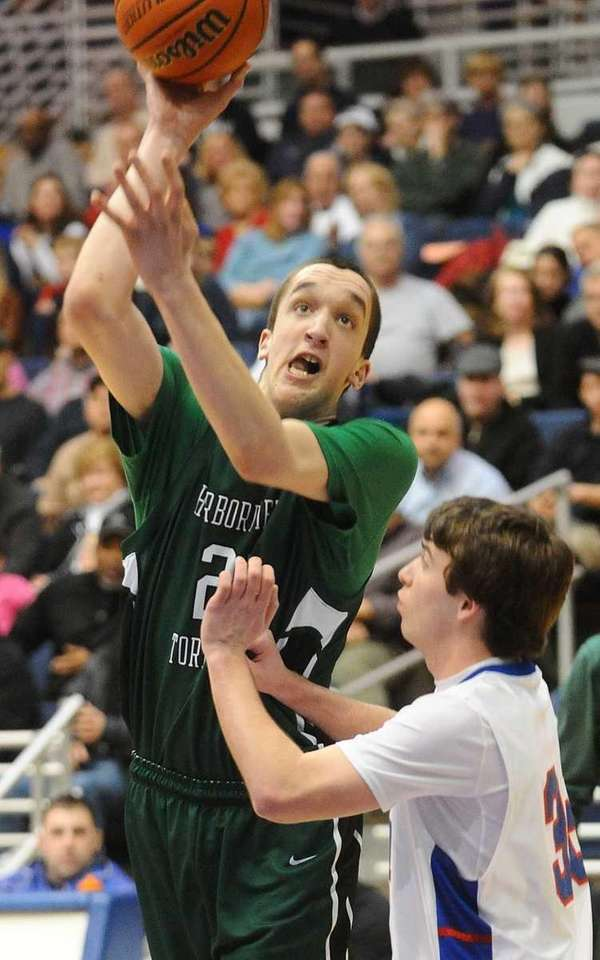 Harborfields senior Reed McLean, left, attempts to shoot