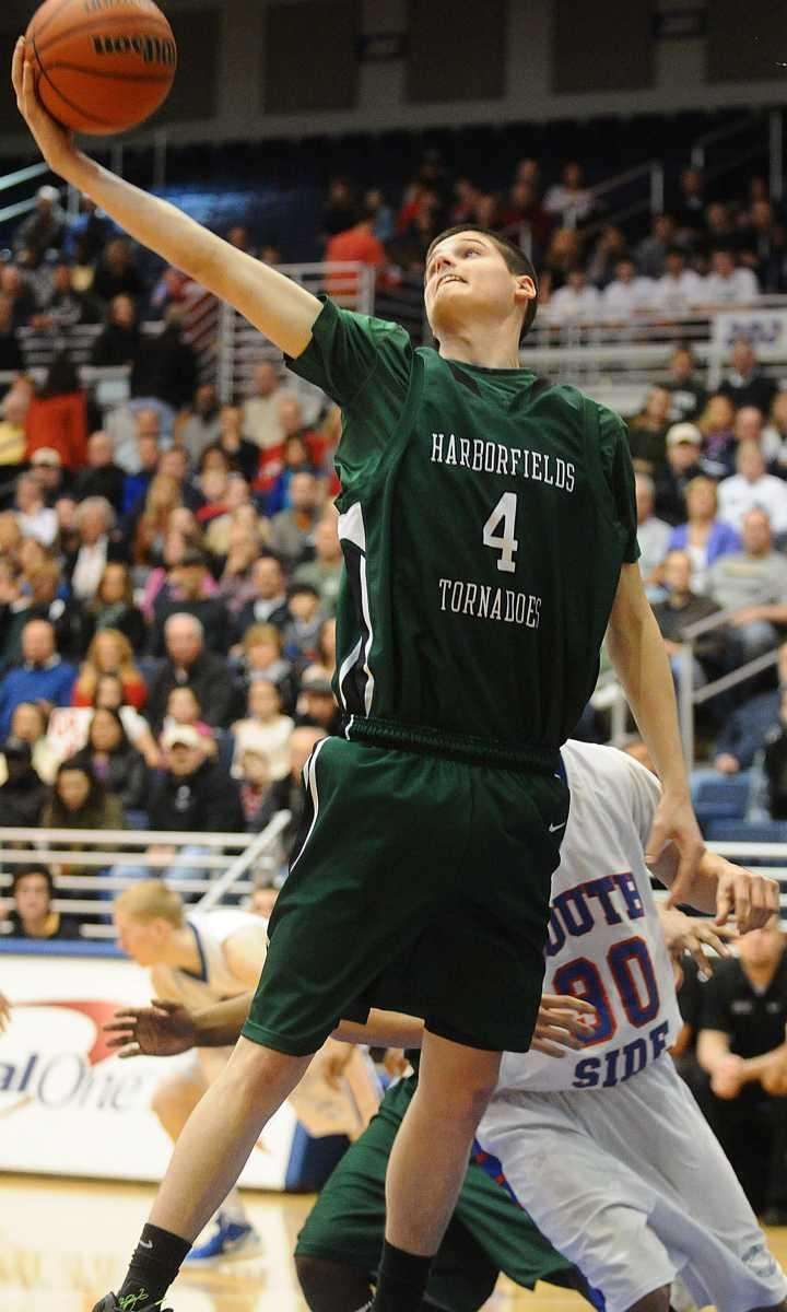 Harborfields' Justin Ringen grabs a rebound in the