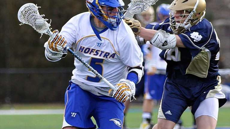 Hofstra midfielder Steve Serling moves the ball into
