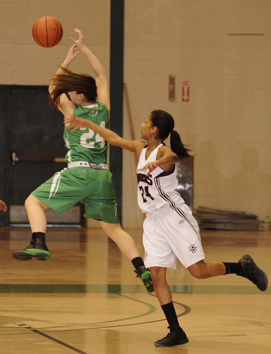 Irvington guard Brittni Lai attempts to intercept a