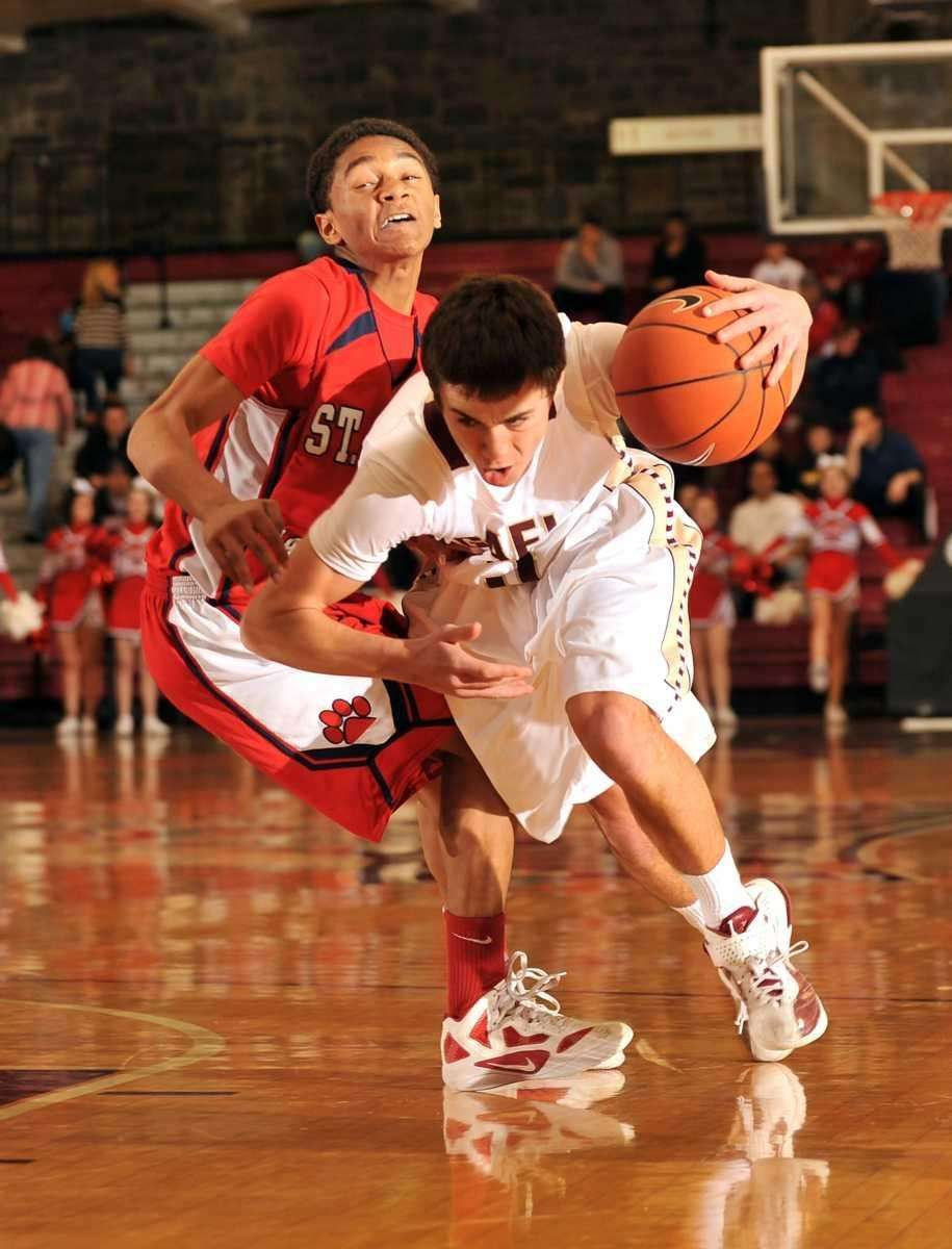 Iona Prep's Luke Wooters brushes into St. John