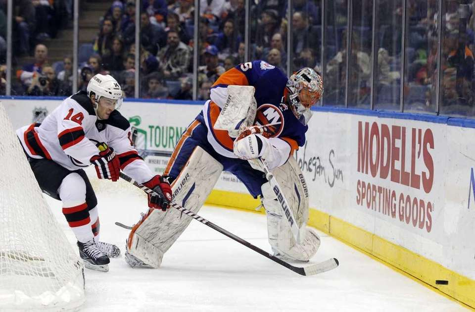 Anders Nilsson of the Islanders clears the puck