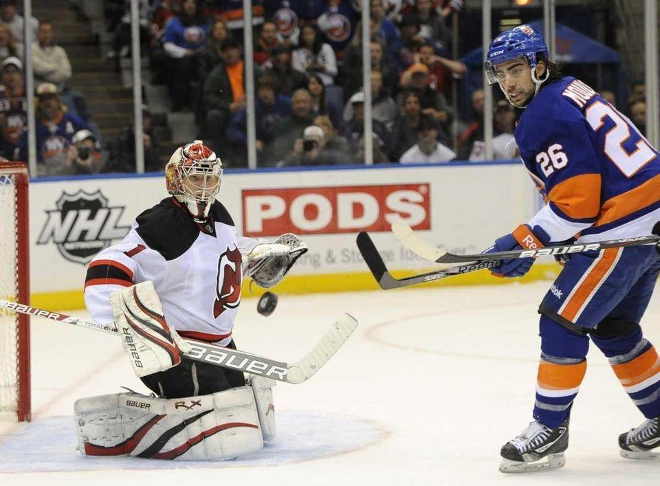 Islanders' Matt Moulson watches New Jersey Devils goalie