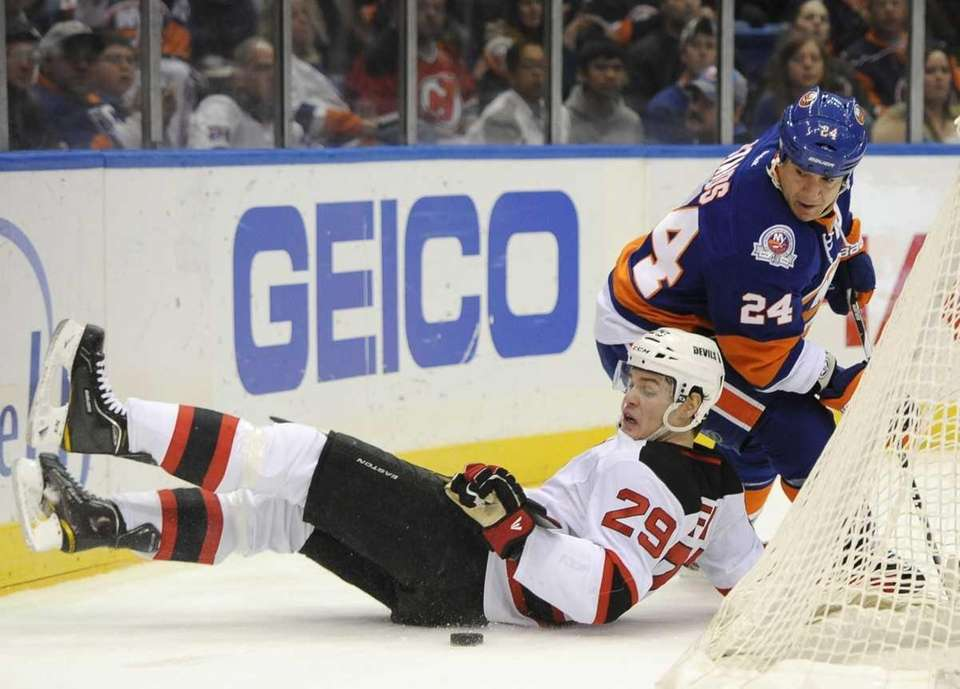 New Jersey Devils' Mark Fayne falls to the