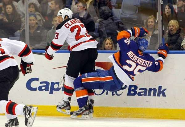 David Clarkson of the New Jersey Devils checks