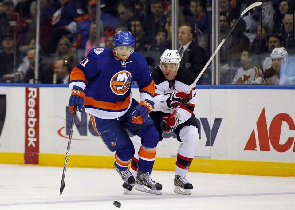 David Ullstrom of the Islanders controls the puck