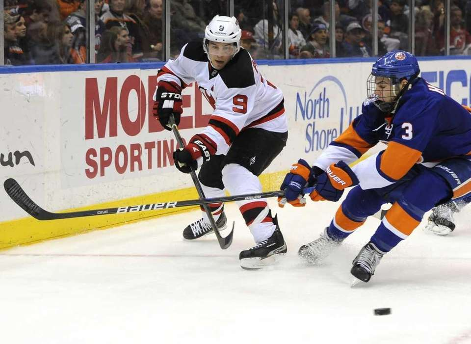 New Jersey Devils' Zach Parise drives the puck