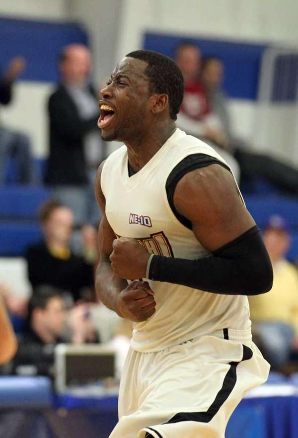 Adelphi guard Chris Ranglin celebrates after taking the