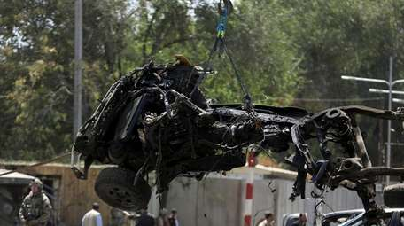 The remnants of a vehicle are removed in