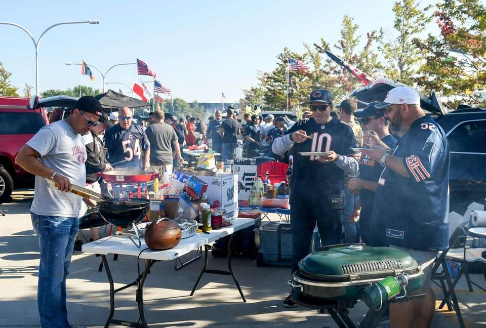 Fans tailgate outside Soldier Field before an NFL