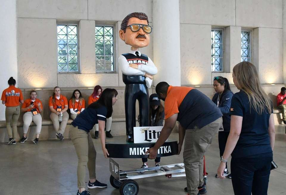 A large bobblehead of Mike Ditka is seen