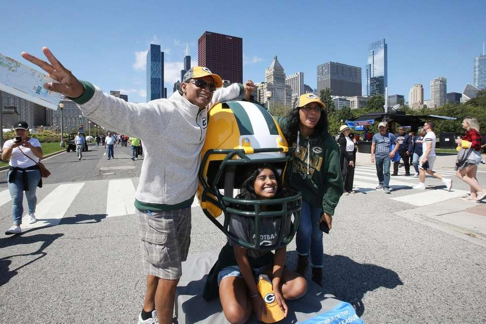 Green Bay Packer fans pose with a giant