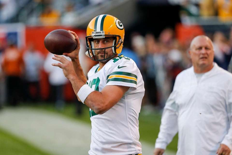 Green Bay Packers' Aaron Rodgers warms up before