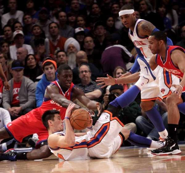 New York Knicks' Jeremy Lin, bottom, fights for